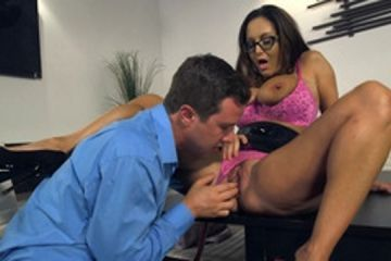 A busty milf with glasses is fucked in the conference room