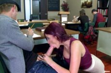 Redhead with glasses making a blowjob and sex in library