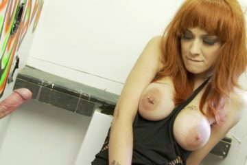 Glory hole part 1 Redhead with amazing bouncy tits sucks dick through a glory hole