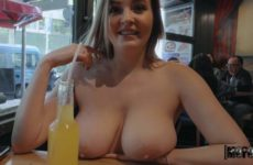 Woman undresses for money in a public place